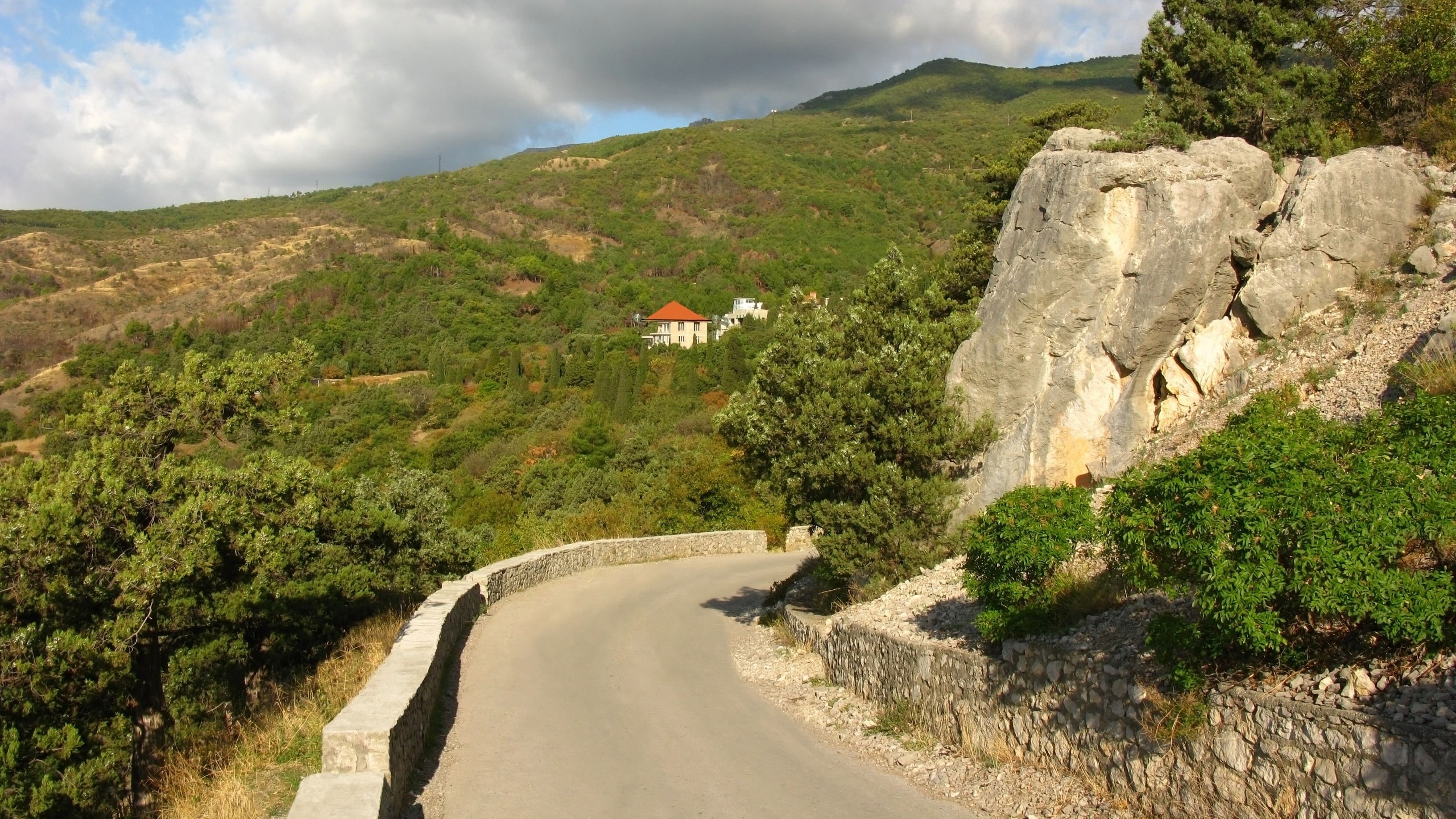 Mountainous landscape with serpentinous road.