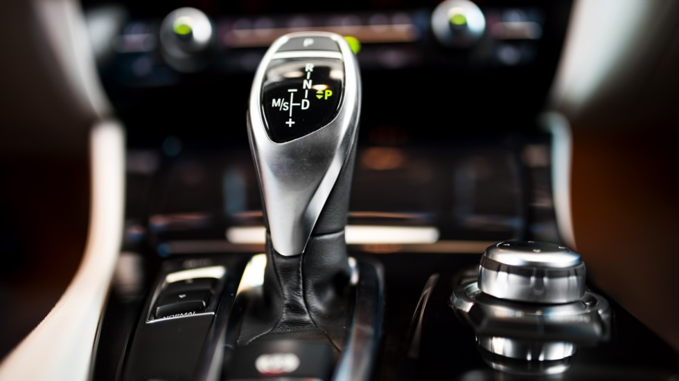Detail of an automatic gear shifter in a new, modern car. Modern