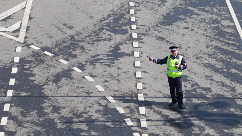 Police officer regulating traffic, Moscow
