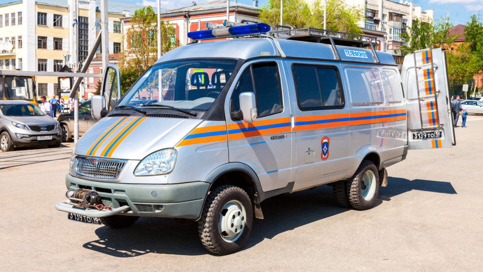 Rescue vehicle parked up in the street in sunny day