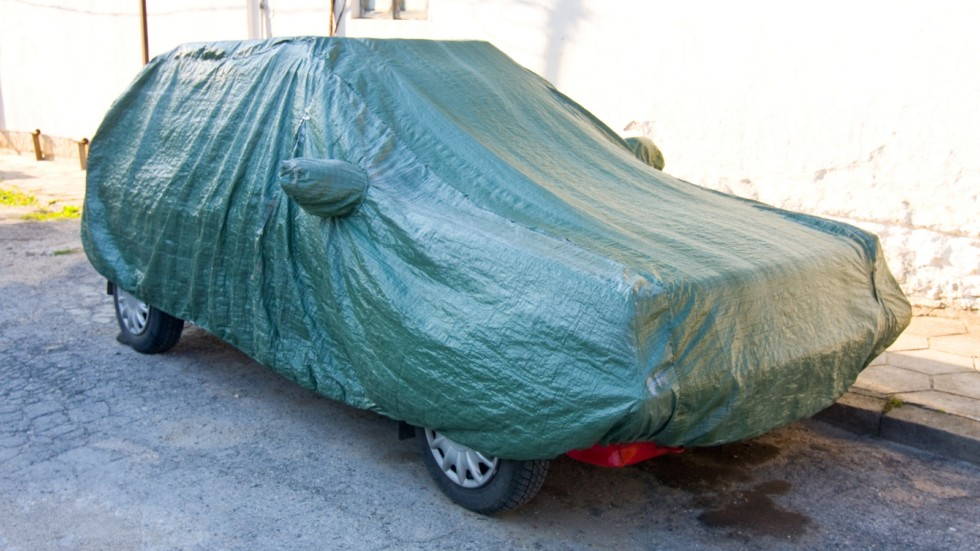 A parked car with protective cover