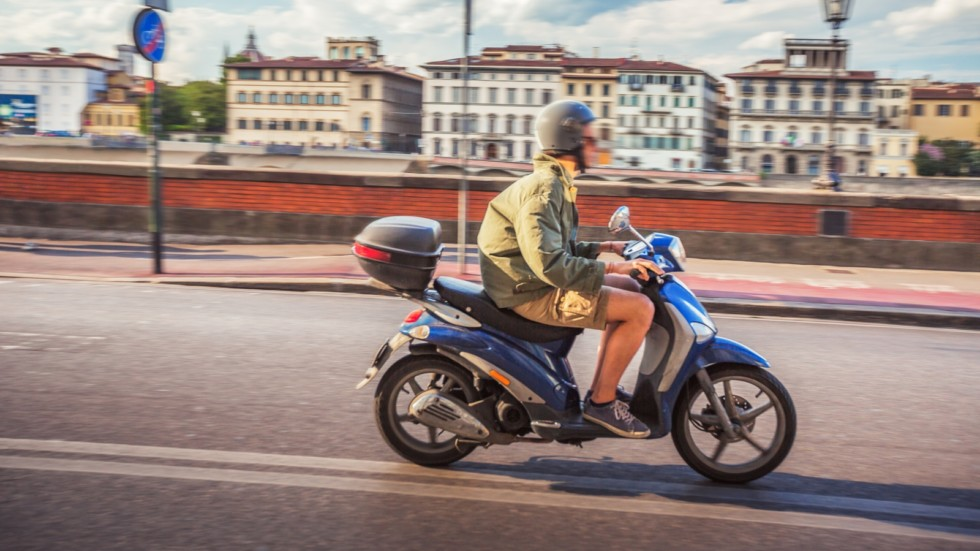 Boy racing motorbike in the streets of Florence