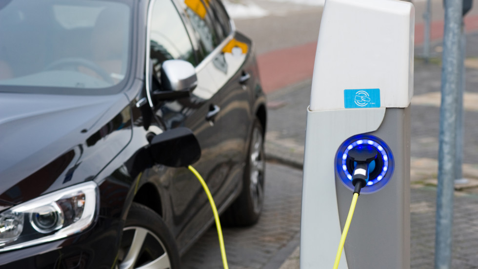 Electric car at charging station