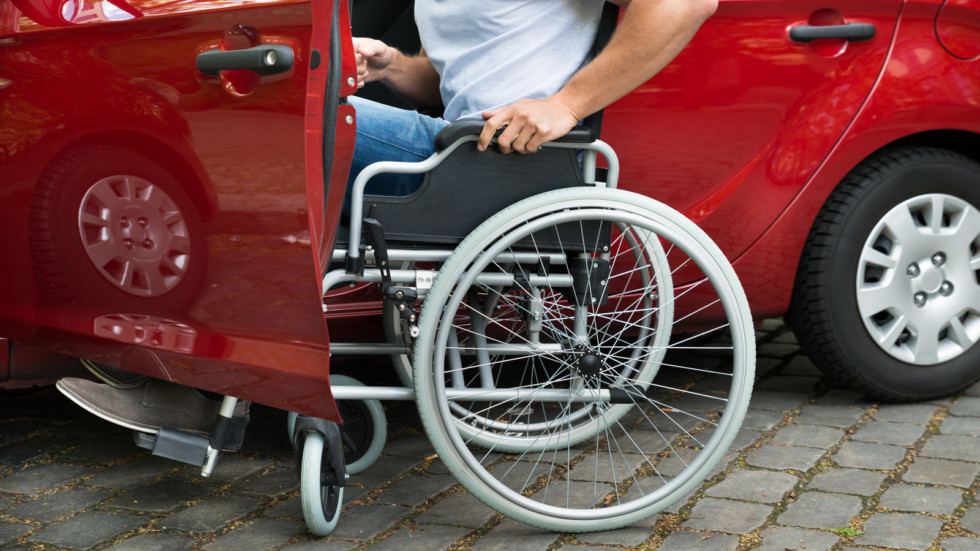 Disabled Man Boarding In His Car