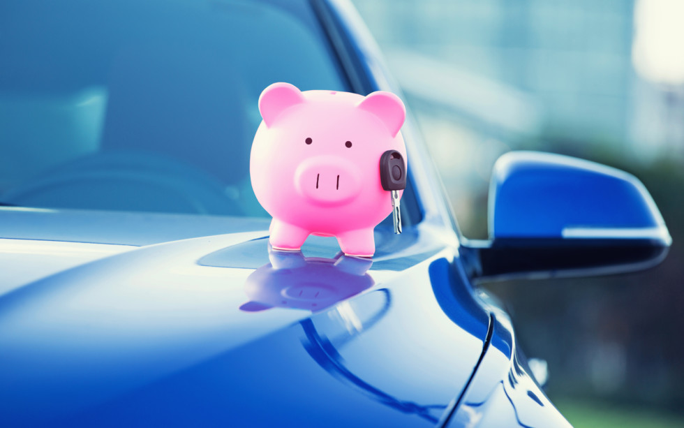 new car with piggy bank, key on hood