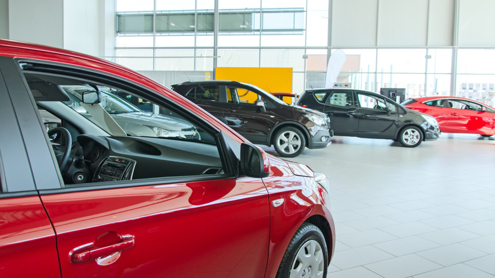 Several new cars at dealership salon.