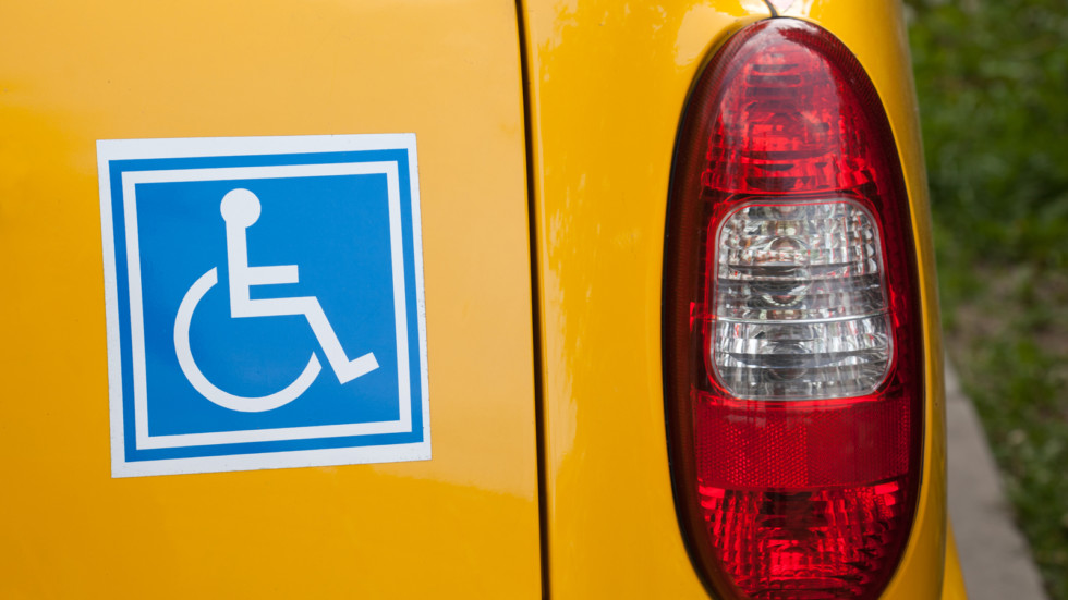 Handicapped sign on back of car