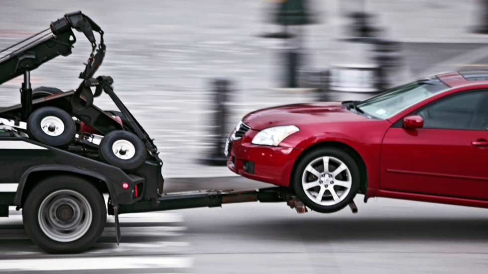 tow truck delivers the damaged vehicle