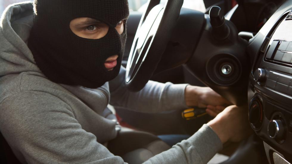 Thief Using Screwdriver In Car