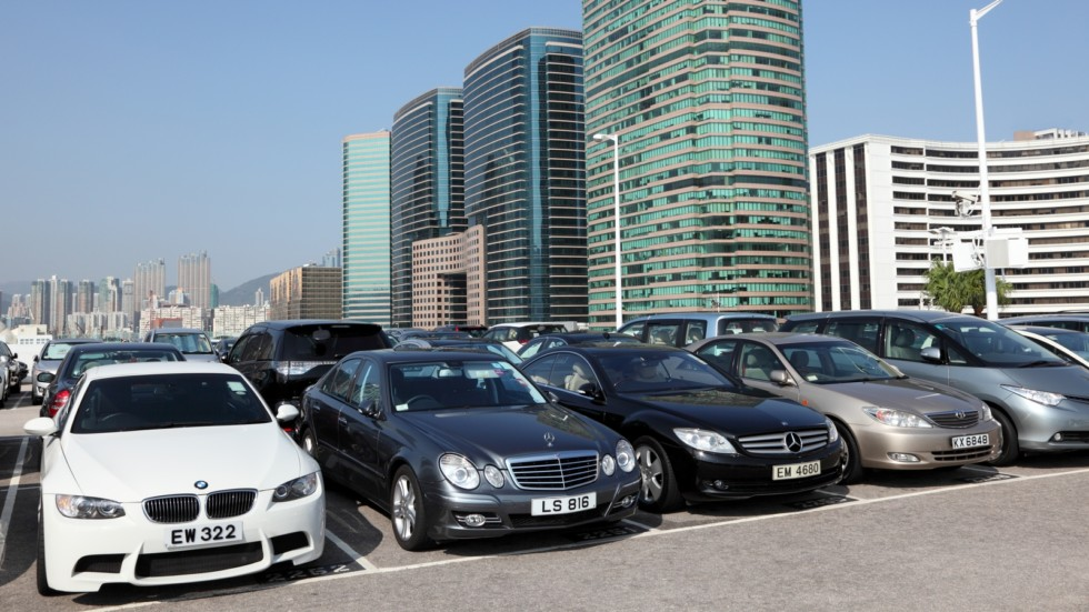 Luxury cars in parking lot in Hong Kong