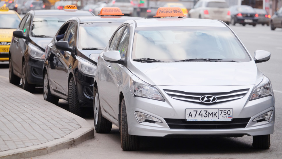 Taxis waits for passengers. Taxi cars on the street of Moscow