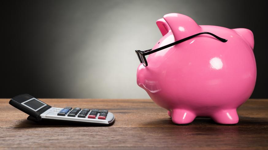 Pink Piggybank And Calculator